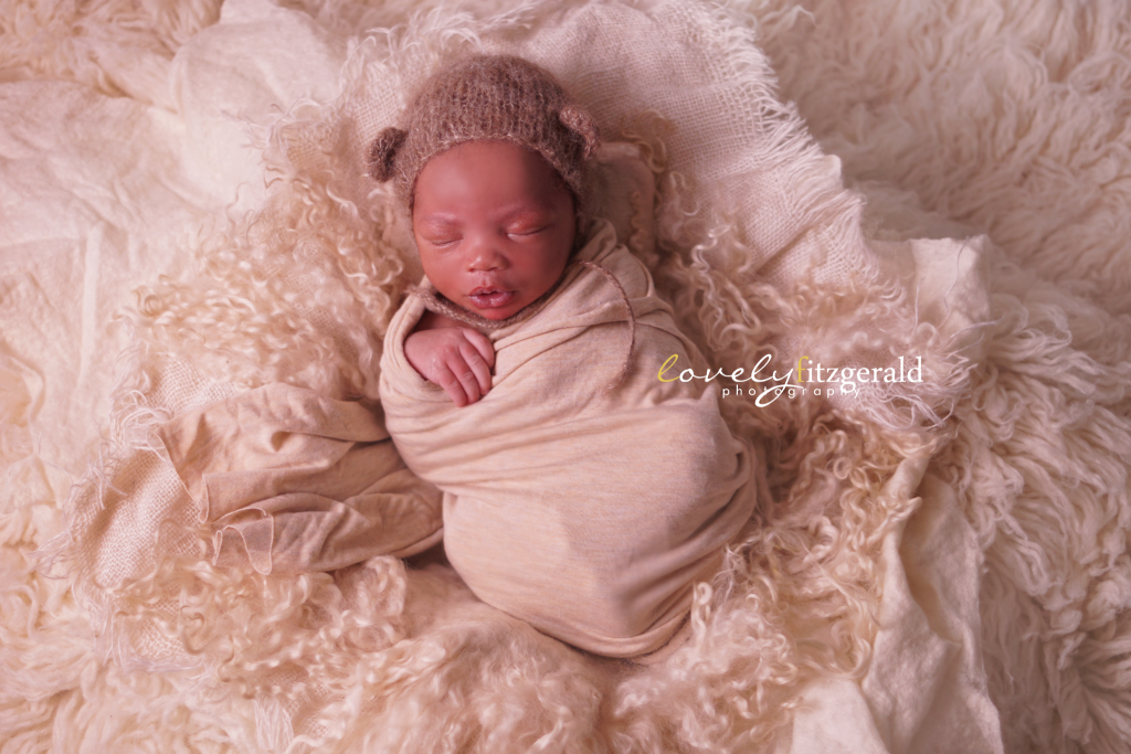 newborn baby boy with bear hat | frisco newborn photographer