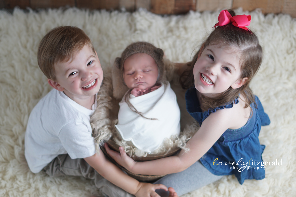 siblings with new baby, frisco newborn photographer