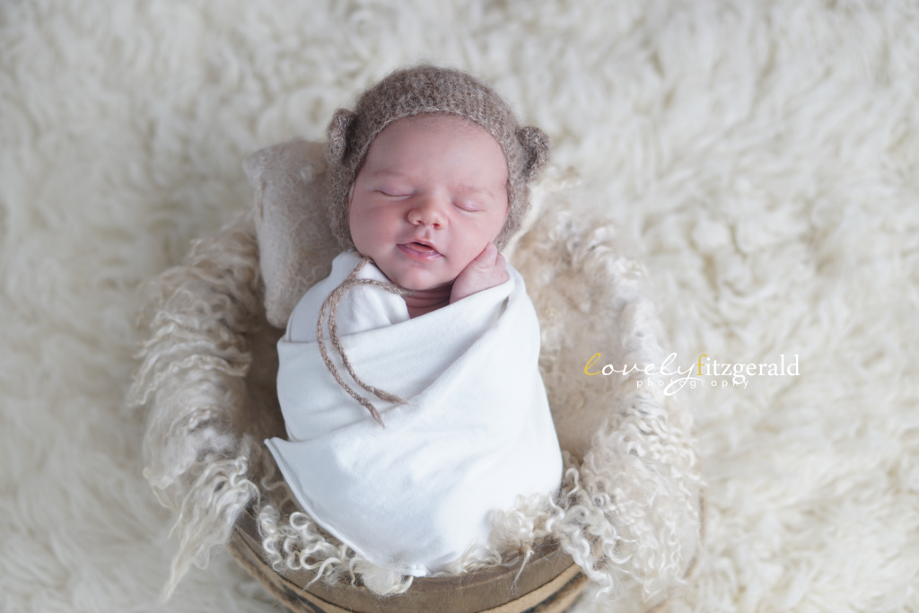 smiling newborn in bonnet, the colony newborn photographer
