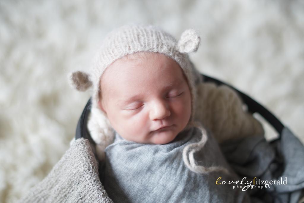 the colony newborn photographer baby in bear bonnet
